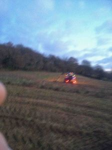 Tractor finishing cutting of field in the dark - December 2014