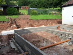 dug out area for steps to garden can be seen behind new brickwork