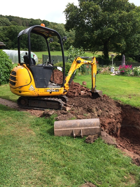 Digger to remove remaining soil for steps