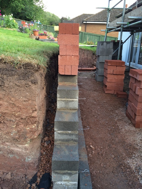 Filling back of retaining wall