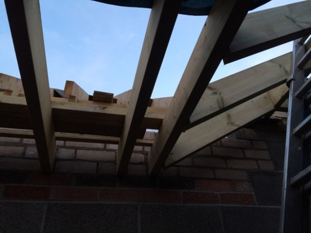 close-up-of-new-sloping-beams-to-accomodate-head-height-for-steps-which-have-yet-to-be-built-to-reach-new-level-of-kitchen
