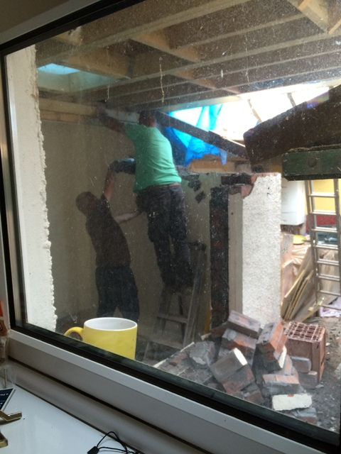 drilling-and-loosening-brick-work-in-new-doorway-before-inserting-2-new-lintels