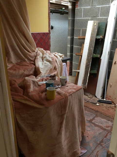 everything-covered-to-protect-from-very-fine-red-brick-dust-after-cutting-grooves-for-new-doorway-in-utility-room-2