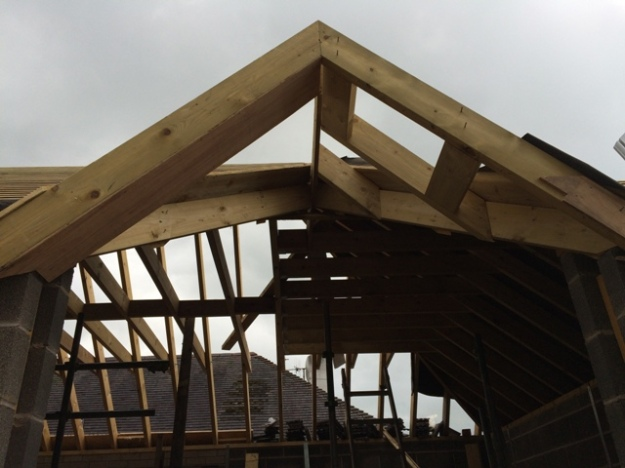 hip-roof-being-reconstructed