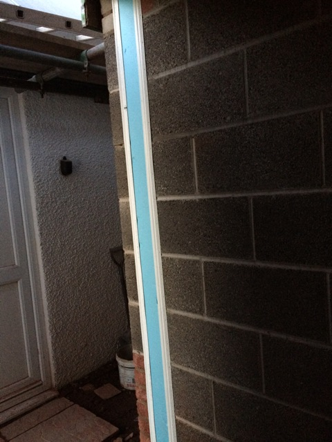 installation-of-plastic-and-foam-lining-to-seal-cavity-around-door