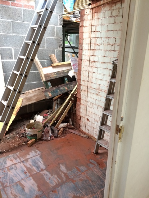 rubble-and-plaster-board-from-utility-wall-also-see-vertical-cuts-in-wall-which-will-be-the-door-opening-into-the-new-bathroom
