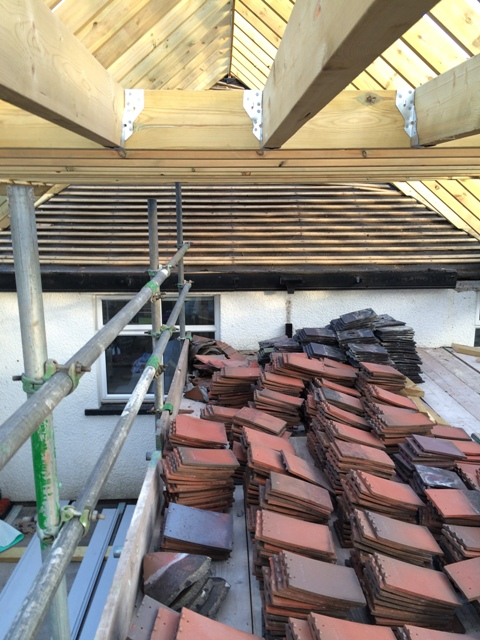 Up on Scaffolding - Tiles all removed from old existing roof over utility room and small bedroom