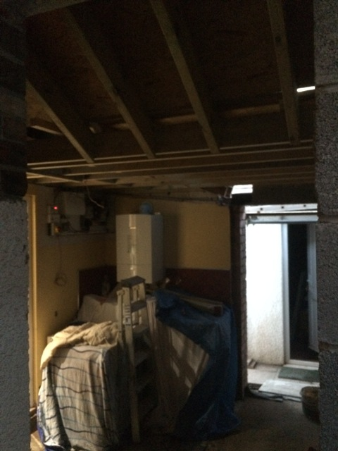 view-into-utility-room-from-new-kitchen-fibre-boards-in-place-on-roof