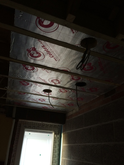 beginning-of-celotex-insulation-between-roof-and-beams-in-utility-room-cut-around-extractor