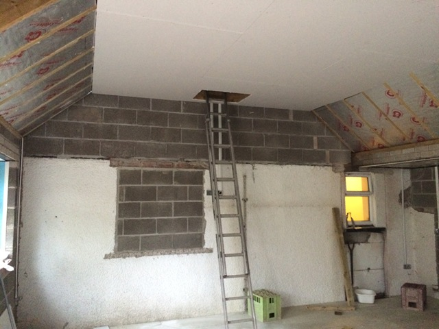 left-hand-side-of-kitchen-showing-new-plaster-board-and-hatch