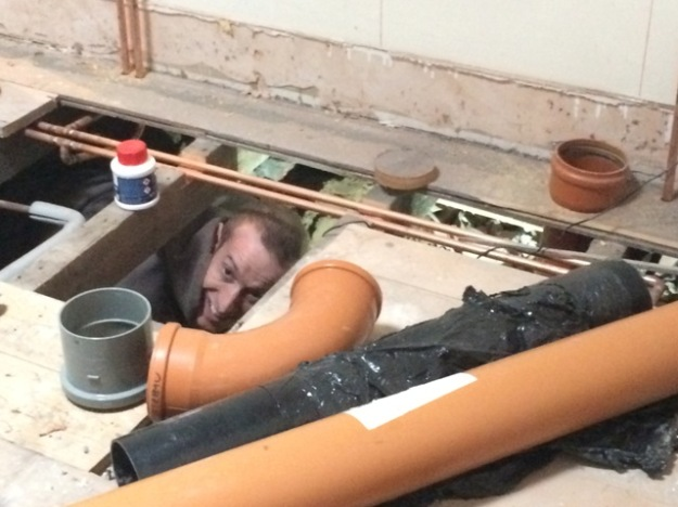 marcus-the-plumber-in-a-very-tight-spot-under-the-floor-in-the-new-bathroom