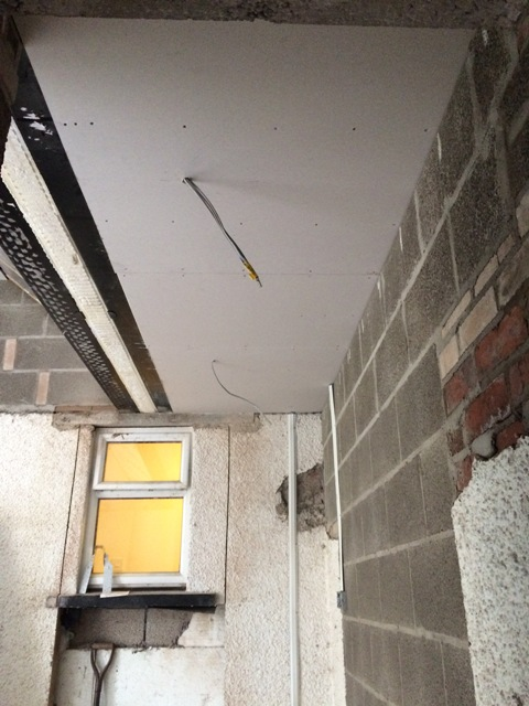 new-plasterboard-ceiling-in-entrance-to-kitchen-beneath-flat-roof