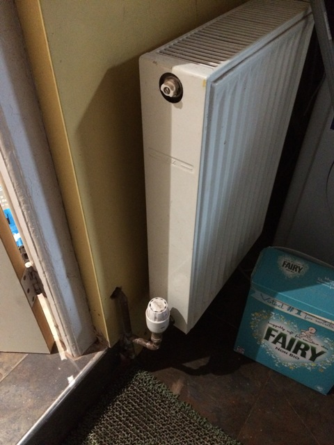 old-radiator-in-utility-reconnected-now-re-routed-under-house