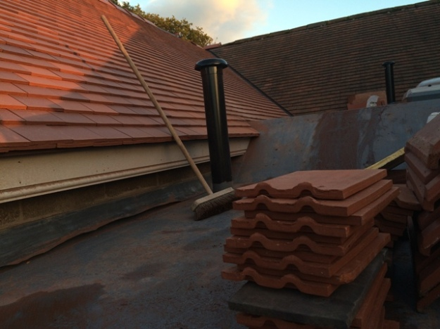 roof-between-old-and-new-building-from-step-ladder