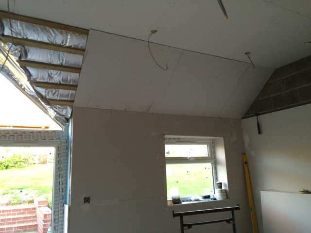 blanket-insulation-in-sloping-roof-covered-by-plasterboard