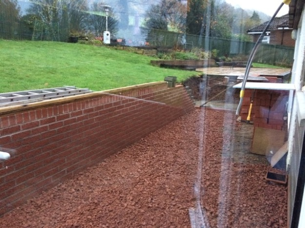 chippings-used-right-along-the-back-of-the-house-in-preparation-for-new-slabs-being-laid