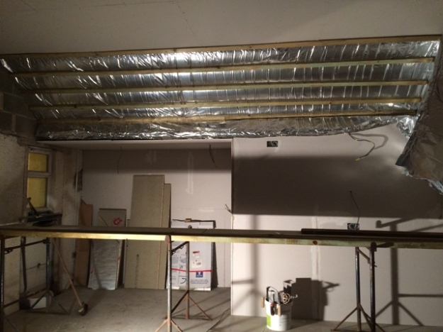 foil-insulation-going-into-sloping-roof-of-kitchen