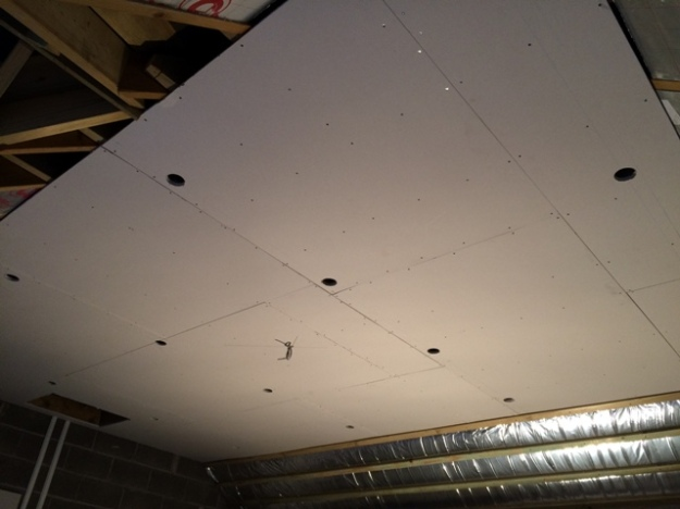holes-cut-in-plasterboard-for-lighting-lots-of-it