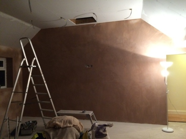 large-wall-adjacent-to-main-bedroom-now-plastered