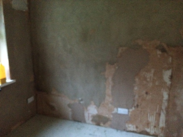 new-small-bedroomblurred-picture-no-light-walls-prepared-for-plastering