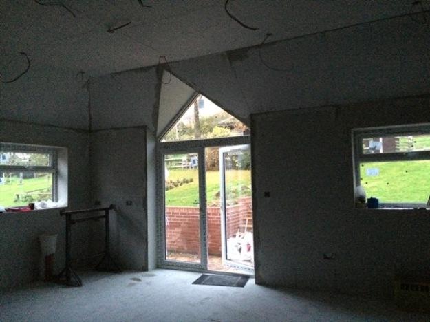 new-triangular-window-over-patio-door
