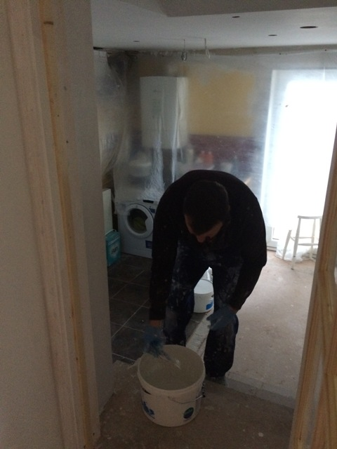 paul-painting-another-coat-to-utility-ceiling