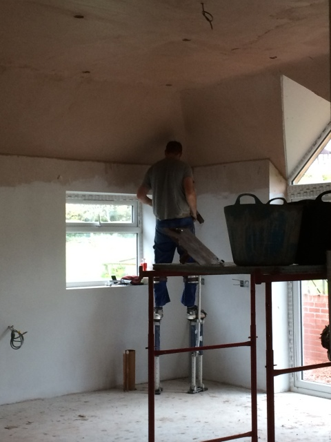 plasterers-at-work-on-stilts-3