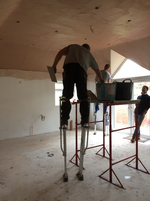 plasterers-at-work-on-stilts