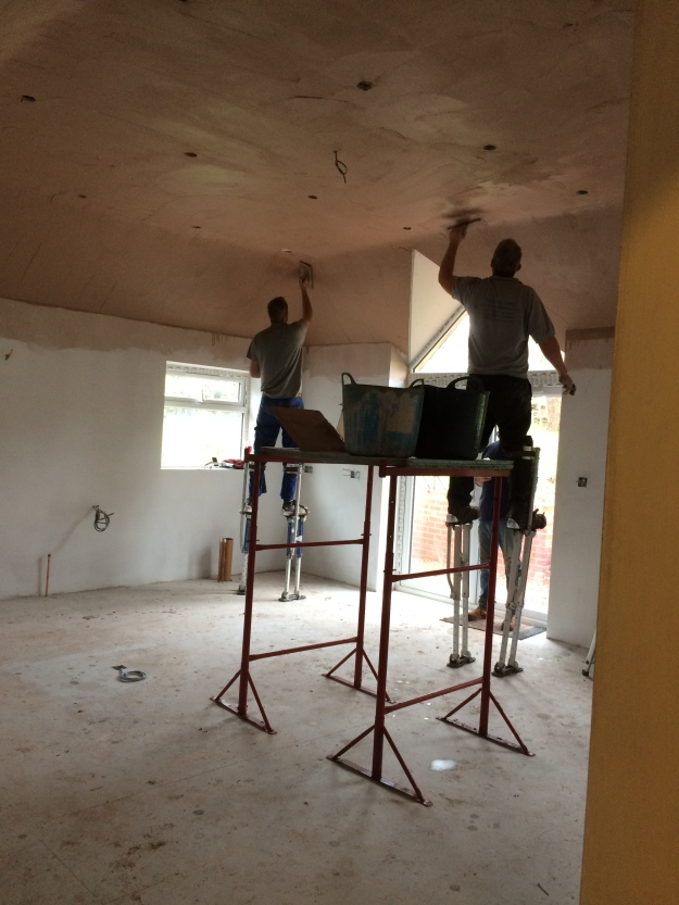 plasterers-on-stilts-skimming-the-very-high-ceiling-this-was-amazing