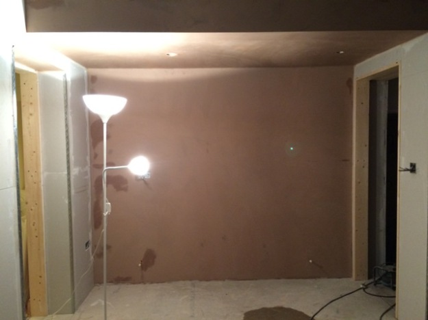 plastering-along-back-wall-of-kitchen-adjacent-to-2-doorways