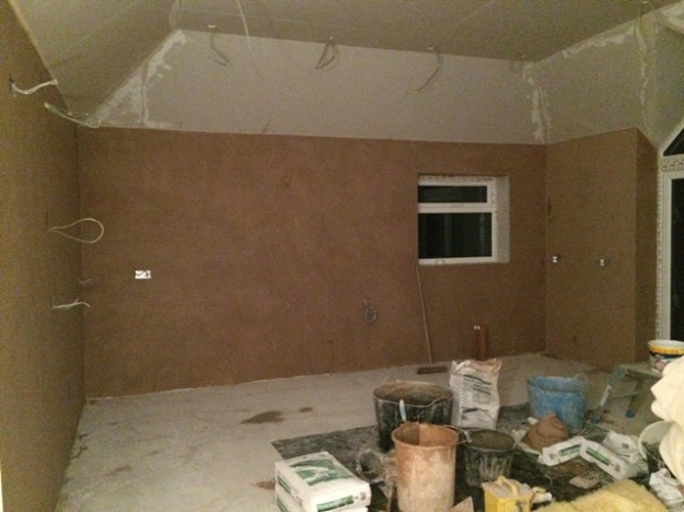 plastering-along-wall-adjacent-to-garage