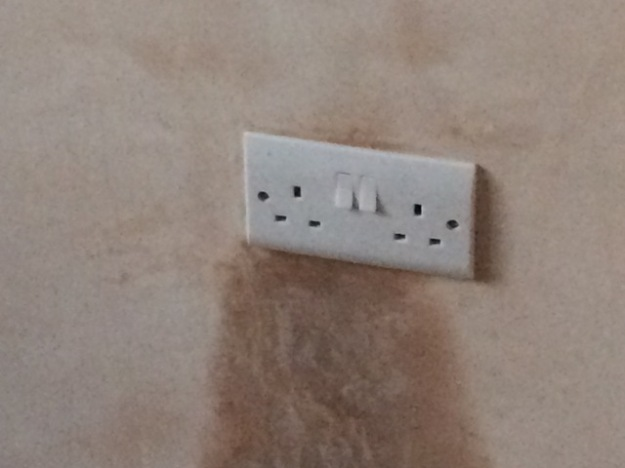 plug-sockets-wired-up-in-small-bedroom-after-plastering