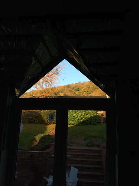 view-through-new-kitchen-patio-windows-up-the-hillside-lovely-autumnal-day
