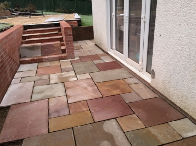 slabs-cut-for-patio-indian-sandstone-all-vary-in-colou-creating-a-patterned-effect