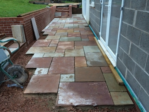 slabs-now-being-cemented-into-place-for-new-patio-at-back-of-new-kitchen