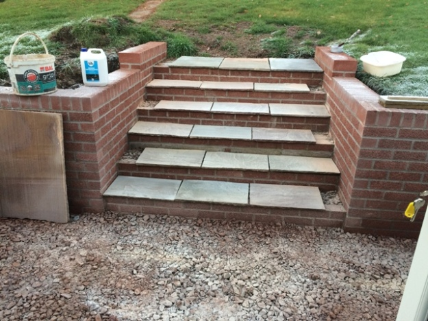 steps-with-cut-indian-sandstone-slabs-too-cold-for-laying