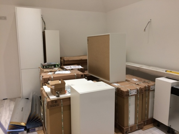 tall-kitchen-cabinet-and-base-kitchen-units-going-into-place