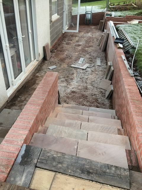 view-from-main-patio-along-back-of-house-slabs-cut-ready-for-laying