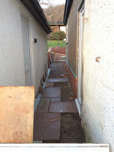 walkway-between-new-kitchen-an-garage-slabs-being-laid-also-scratch-coat-on-new-kitchen-outside-wall
