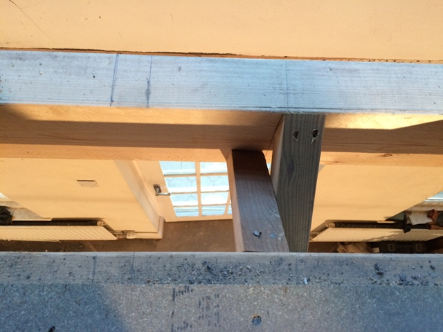 photo-through-gap-in-the-new-flooring-showing-the-inner-porch-door-below