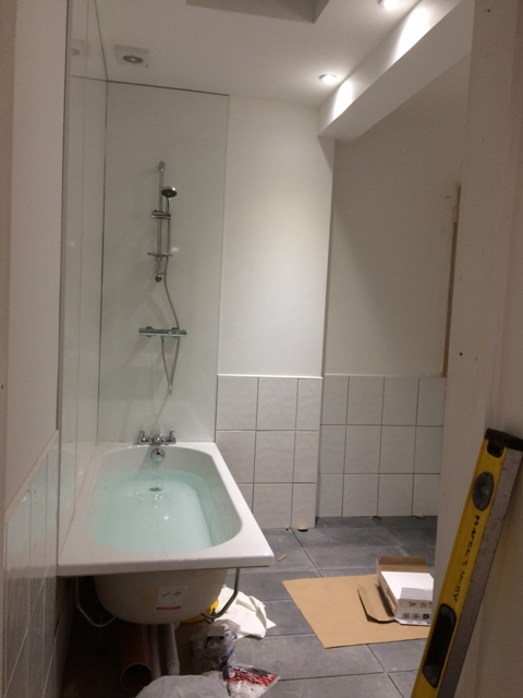 progress-in-new-bathroom-shower-bords-up-bath-fitted-shower-fitted