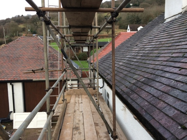 scaffolding-from-outside-along-left-side-of-house