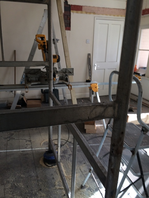 scaffolding-in-large-hall-and-cutting-equipment-for-new-beams-for-bedroom