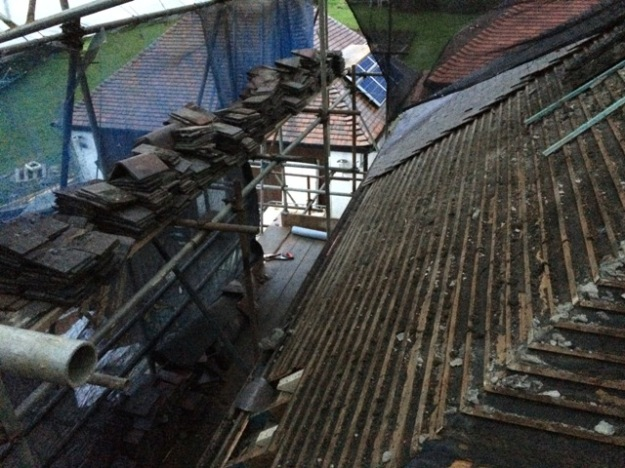 tiles-all-stacked-to-be-reused-for-new-roof-down-side-of-scaffolding