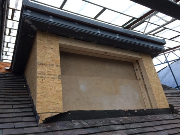 dormer-window-boarded-up-and-flat-roof-has-had-fibre-glass-applied