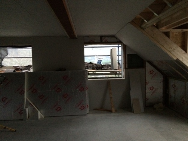 large-amounts-of-insulation-going-into-ceilings-of-new-upstairs-sloping-roof-and-walls