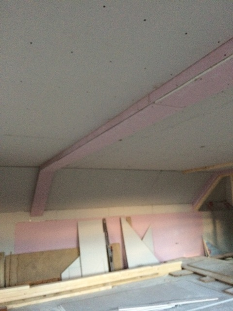 plasterboarding-in-pink-around-the-steel-beam