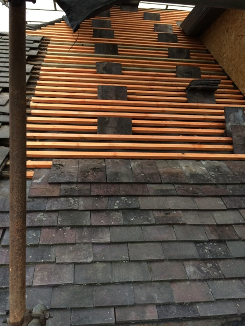 right-side-of-roof-tiles-are-now-being-put-back-on-2-roofers-today