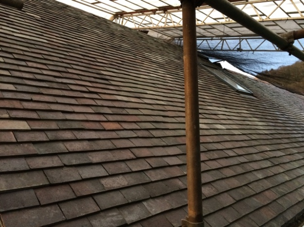roof-tiled-on-the-right-side-of-house-and-around-the-velux