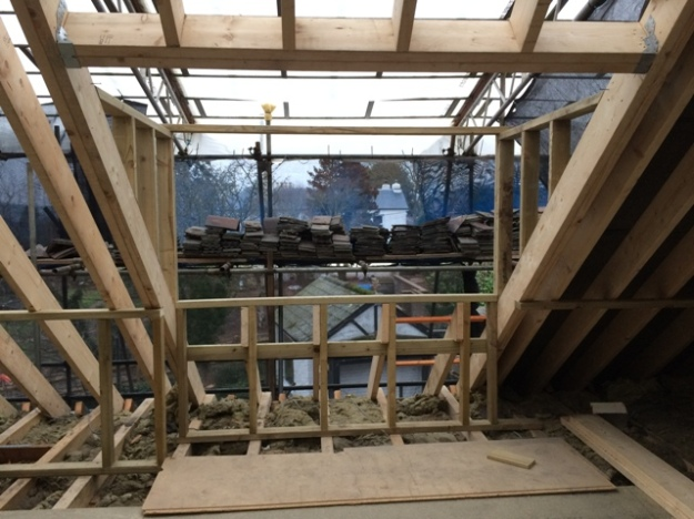 the-initial-construction-of-the-dormer-in-the-left-side-of-the-new-bedroom-upstairs